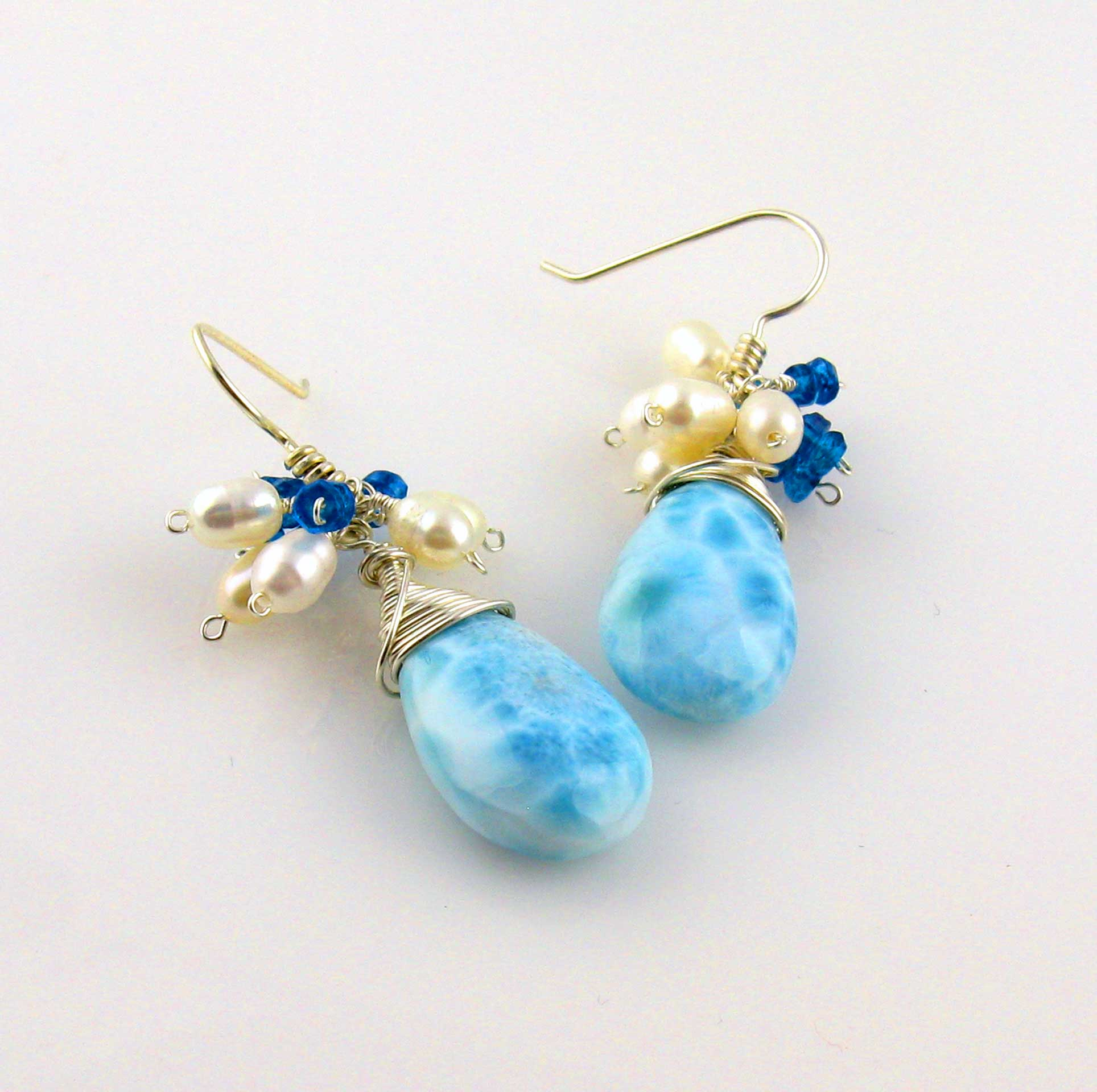 gold earrings with white gemstone in stud blue topaz